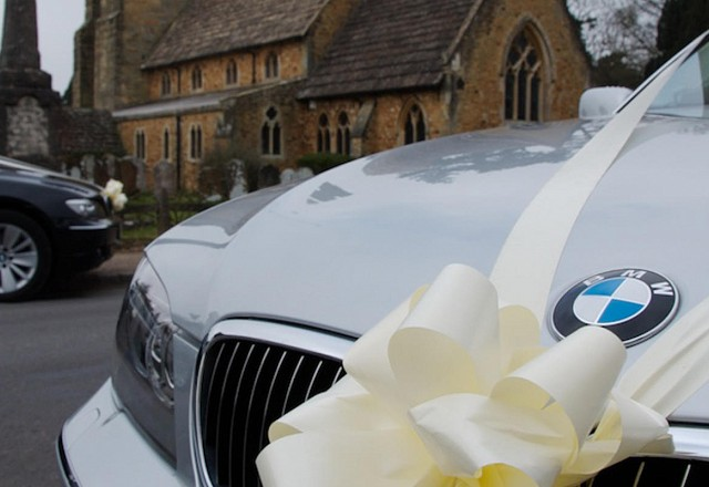 Wedding cars at a church